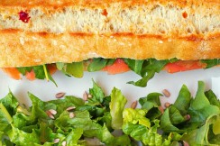 Photograph of salmon baguette and salad from The French House, Lake Worth, Florida.
