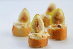 Photograph of figs and goat cheese of crostini.