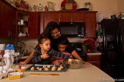 Mother and children baking Christmas cookies together
