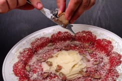 white truffles shaved on beef carpaccio in Boca Raton