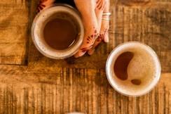 Henna hands holding kombucha tea