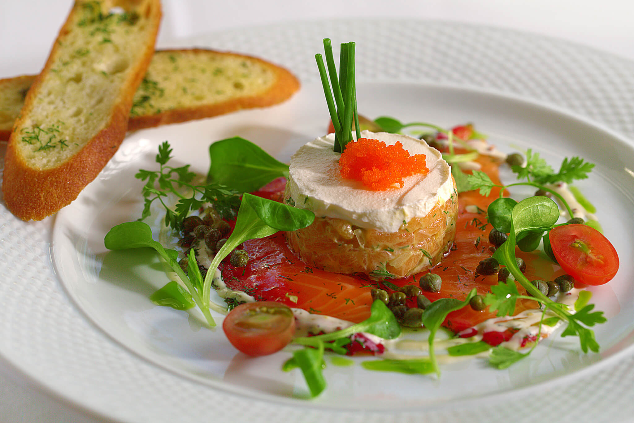 ... hot smoked cured bacon salmon gravlax tartare on crisp potato slices